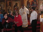 Faithful venerate Cross at end of Liturgy