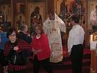 Faithful venerate Cross at end of Liturgy