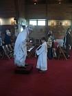 Server Luke Kowaleski holds liturgy book for Bishop Nikon