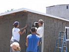 Mark, Tatianna, and Andrew (PA) put finishing touches on stucco