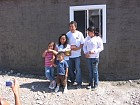 Angelica, Santos, and children in front of their new home.  May God grant them Many Years!