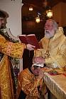 Bishop Job prays over Fr. Nicholas
