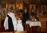 Fr. John and Caroline, with her Godparents, Mark and Karry Orelup, circle the Baptismal Font in festive procession following Caroline's Baptism
