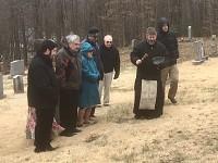 Fr. John begins to bless the graves